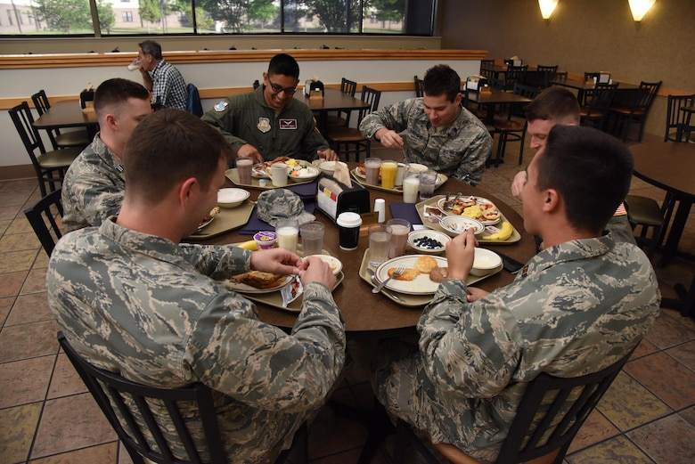 Air Force ROTC cadets eat breakfast in the Azalea Dining Facility during Pathways to Blue April 7, 2017, on Keesler Air Force Base, Miss. Pathways to Blue, an annual event hosted by 2nd Air Force with the support of the 81st Training Wing and the 403rd Wing, allowed cadets to receive hands-on briefings with technical and flying operations and an orientation flight in support of the Air Force's Diversity Strategic Roadmap program. (U.S. Air Force photo by Kemberly Groue)
