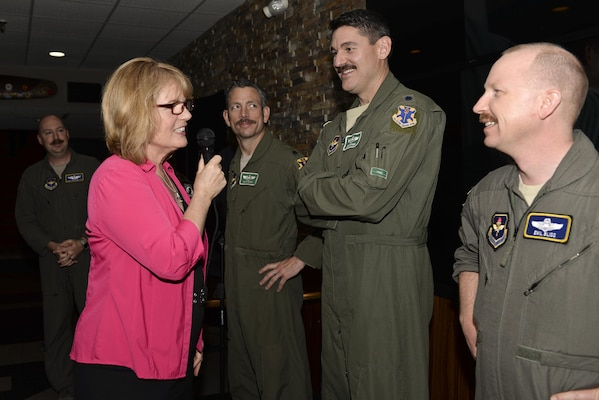 Christina Olds, daughter of retired Brig. Gen. Robin Olds, examines mustaches to determine the one that best conveys her father's legendary spirit at the Auger Inn on Joint Base San Antonio-Randolph, Texas, March 30, 2017. Olds visit was part of the activities for the 44th Freedom Fighters Reunion honoring POW/MIA pilots. (U.S. Air Force photo by Staff Sgt. Michelle Patten)