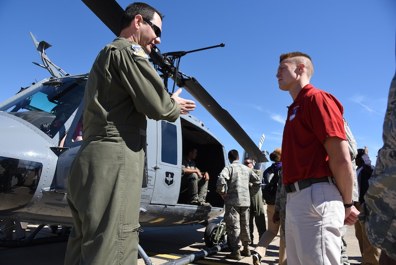 Maj. Colin McDonald, 23rd Flight Training Squadron wing flight safety officer, Fort Rucker, Alaska, briefs Cadet Casey Brumbeloe, Troy University Air Force ROTC cadet, on a TH-1H Huey during Pathways to Blue April 7, 2017, on Keesler Air Force Base, Miss. Pathways to Blue, an annual  event hosted by 2nd Air Force with the support of the 81st Training Wing and the 403rd Wing allowed cadets to receive hands-on briefings with technical and flying operations and an orientation flight in support of the Air Force's Diversity Strategic Roadmap program. (U.S. Air Force photo by Kemberly Groue)
