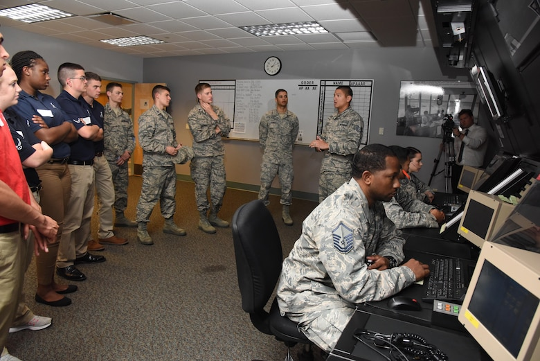 Tech Sgt. Hugh Cross, 334th Training Squadron instructor, briefs Air Force ROTC cadets on an air traffic control radar system in Cody Hall during Pathways to Blue April 7, 2017, on Keesler Air Force Base, Miss. Pathways to Blue, a diversity and inclusion outreach event hosted by 2nd Air Force with the support of the 81st Training Wing and the 403rd Wing. The event provided the 178 cadets who traveled here from seven detachments a chance to interact with officers from 36 different specialties from across the Air Force. (U.S. Air Force photo by Kemberly Groue)