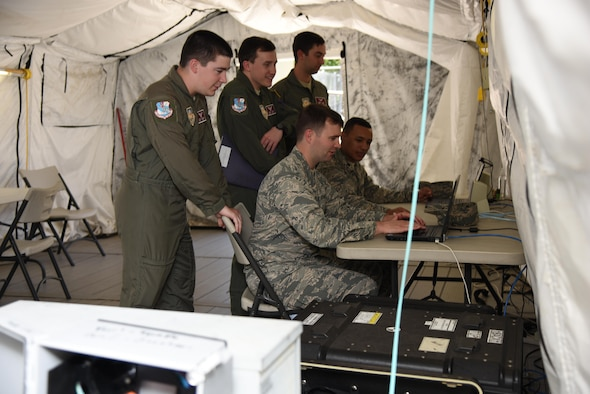 Air Force ROTC cadets simulate troubleshooting on an expeditionary network for the cyber transport systems career field during Pathways to Blue April 7, 2017, on Keesler Air Force Base, Miss. Pathways to Blue is a diversity and inclusion outreach event hosted by 2nd Air Force with the support of the 81st Training Wing and the 403rd Wing. The event provided the 178 cadets who traveled here from seven detachments a chance to interact with officers from 36 different specialties from across the Air Force. (U.S. Air Force photo by Kemberly Groue)