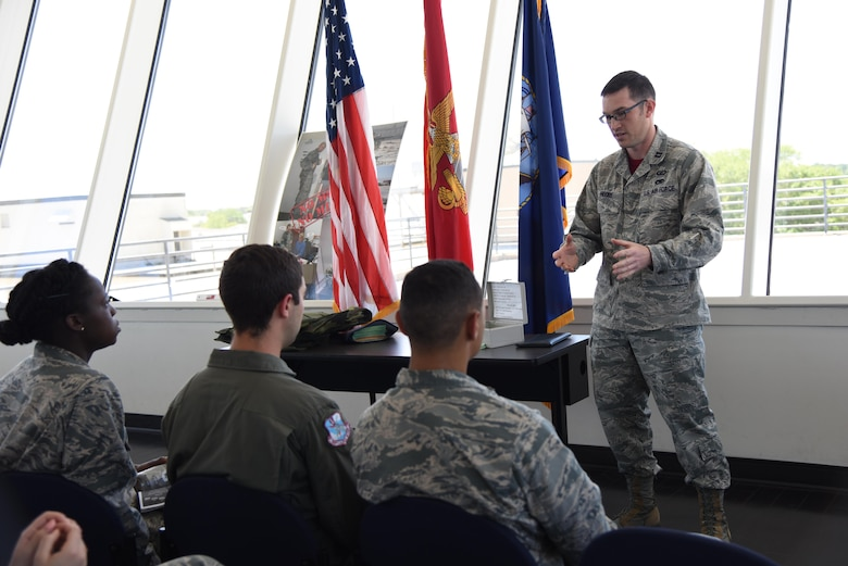 Capt. Nick Moore, 335th Training Squadron comptroller training flight commander, briefs Air Force ROTC cadets on the financial management career field in the weather training complex during Pathways to Blue April 7, 2017, on Keesler Air Force Base, Miss. Pathways to Blue is a diversity and inclusion outreach event hosted by 2nd Air Force with the support of the 81st Training Wing and the 403rd Wing. The event provided the 178 cadets who traveled here from seven detachments a chance to interact with officers from 36 different specialties from across the Air Force. (U.S. Air Force photo by Kemberly Groue)