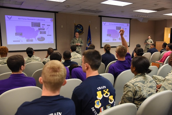 Second Lt. Dylan Slizewski, Air Force Research Laboratory explosive research chemist, Eglin Air Force Base, Fla., briefs Air Force ROTC cadets on  on one of many an AFRL career field in McClelland Hall during Pathways to Blue April 8, 2017, on Keesler Air Force Base, Miss. Pathways to Blue is a diversity outreach event hosted by 2nd Air Force with the support of the 81st Training Wing and the 403rd Wing. The event provided the 178 cadets who traveled here from seven detachments a chance to interact with officers from 36 different specialties from across the Air Force. (U.S. Air Force photo by Kemberly Groue)
