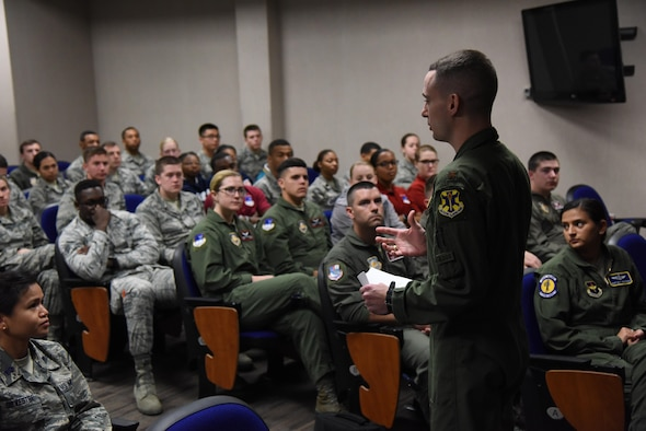 Maj. Jordan Smith, 558th Flying Training Squadron instructor pilot, Joint Base San Antonio-Randolph, Texas, briefs Air Force ROTC cadets on the remotely piloted aircraft career field in the 53rd Weather Reconnaissance Squadron auditorium during Pathways to Blue April 8, 2017, on Keesler Air Force Base, Miss. Pathways to Blue is a diversity and inclusion outreach event hosted by 2nd Air Force with the support of the 81st Training Wing and the 403rd Wing. The event provided the 178 cadets who traveled here from seven detachments a chance to interact with officers from 36 different specialties from across the Air Force. (U.S. Air Force photo by Kemberly Groue)