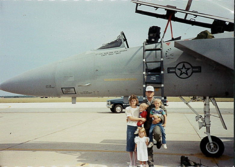 (Right) Rob Wright holds his son, Wes, and poses for a photo with the rest of his family by an F-15 on the Eglin Air Force Base, Florida, flightline circa 1989. Experiences like this formed a positive military childhood experience for Wes, who eventually followed in his father's footsteps and joined the Air Force in 2006. (Courtesy photo)