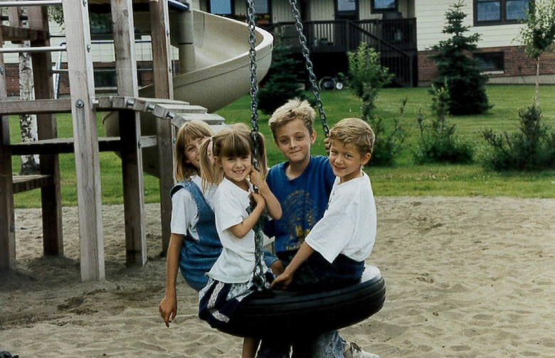 Stacy, Amanda, Wes and Calvin Wright pose for a photo on a playground at Elmendorf Air Force Base, Alaska, in 1995. The Wrights lived in base housing at the time. Positive experiences like this as a military child, would later lead to Wes Wright joining the Air Force in 2006. (Courtesy photo)