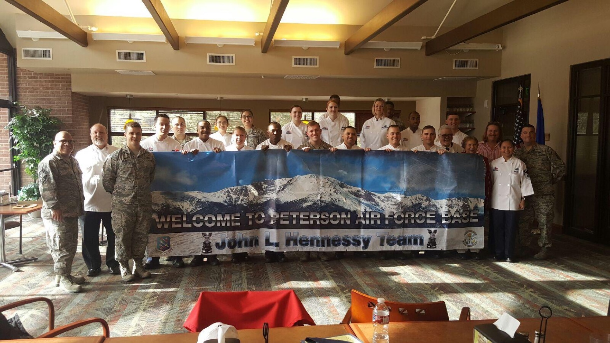 Airmen from the dining facility on Peterson Air Force Base, Colorado, welcome the Hennessy Travelers, who studied all aspects of their operation Feb. 27-28. Peterson was chose as the best U.S. Air Force food service operation in Region 2. (Courtesy photo)