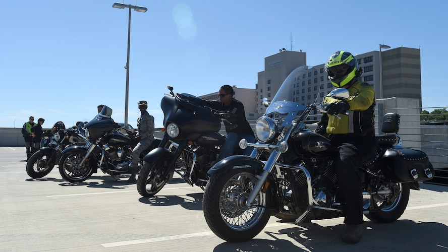 Joint Base San Antonio military members prepare to go out on a ride April 7 during the All Motorcycle Riders Call at Wilford Hall Ambulatory Surgical Center. Safety monitors demonstrated the correct hand signals and proper personal protective gear to use when riding. (U.S. Air Force photo/Staff Sgt. Kevin Iinuma)