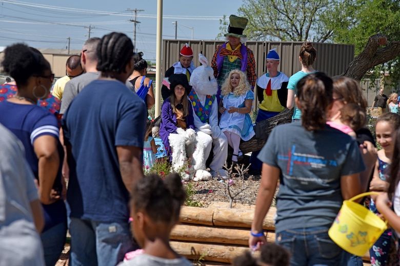Children and parents line up for the Easter Bunny at the Easter Egg Hunt near the school age program area on Goodfellow Air Force Base, Texas, April 8, 2017. The event also had a children's fair. (U.S. Air Force photo by Staff Sgt. Joshua Edwards/Released)