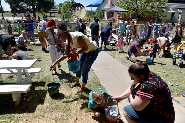 Children hunt for eggs at the Easter Egg Hunt near the school age program area on Goodfellow Air Force Base, Texas, April 8, 2017. The hunt had 5,200 eggs for the children to find. (U.S. Air Force photo by Staff Sgt. Joshua Edwards/Released)