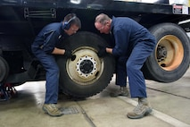 Col. Gregory Wood, 30th Space Wing vice commander, assists Senior Airman Christopher Champagne, 30th Logistics Readiness Squadron vehicle maintainer, remove the wheels of an Altec crane, April 7, 2017, at Vandenberg Air Force Base, Calif. Wood visited the 30th LRS to interact with Airmen and experience the mission.  (U.S. Air Force photo by Tech. Sgt. Jim Araos/Released)