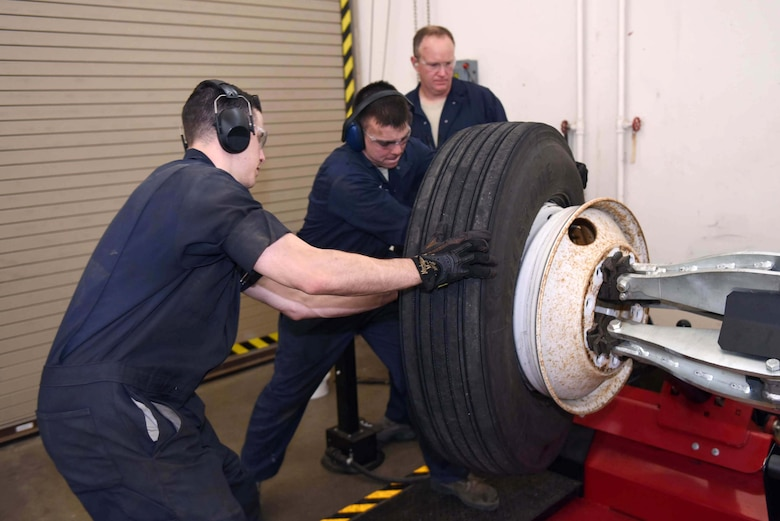 Col. Gregory Wood, 30th Space Wing vice commander, assists Senior Airmen Nathan Sine and Christopher Champagne, 30th Logistics Readiness Squadron vehicle maintainers, change a wheel with a Goats wheel changer, April 7, 2017, at Vandenberg Air Force Base, Calif.  Wood visited the 30th LRS to interact with Airmen and experience the mission.  (U.S. Air Force photo by Tech. Sgt. Jim Araos/Released)