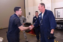 Col. Gregory Wood, 30th Space Wing vice commander, thanks Senior Airman Nathan Sine, 30th Logistics Readiness Squadron vehicle maintainer, April 7, 2017, at Vandenberg Air Force Base, Calif. Wood visited the 30th LRS to interact with Airmen and experience the mission.  (U.S. Air Force photo by Tech. Sgt. Jim Araos/Released)