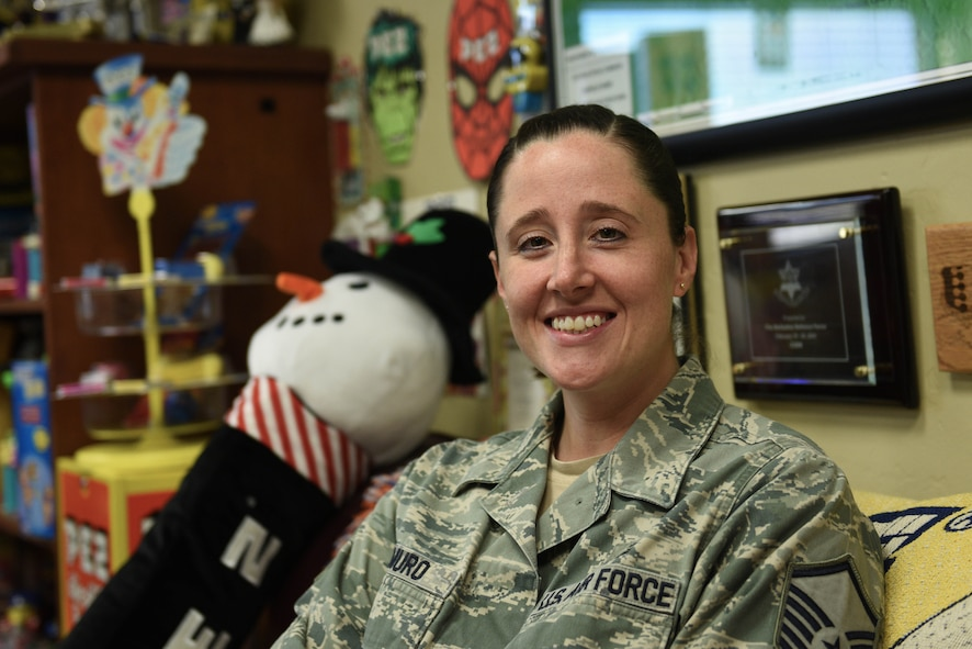 Master Sgt. Linda DeMuro, 30th Operations Support Squadron airfield manager, sits in her office, surrounded by her PEZ collection, April 3, 2017, Vandenberg Air Force Base, Calif. DeMuro, an avid PEZ collector, has been collecting PEZ memorabilia for two decades now and proudly displays the extensive collection around her office. (U.S. Air Force photo by Senior Airman Ian Dudley/Released)