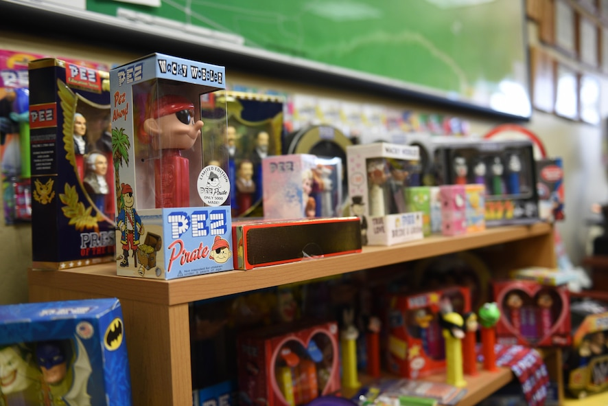 PEZ memorabilia lines the walls and floor of the office of Master Sgt. Linda DeMuro, 30th Operations Support Squadron airfield manager, April 3, 2017, Vandenberg Air Force Base, Calif. DeMuro, an avid PEZ collector, has been collecting PEZ memorabilia for two decades now and proudly displays the extensive collection around her office. (U.S. Air Force photo by Senior Airman Ian Dudley/Released)