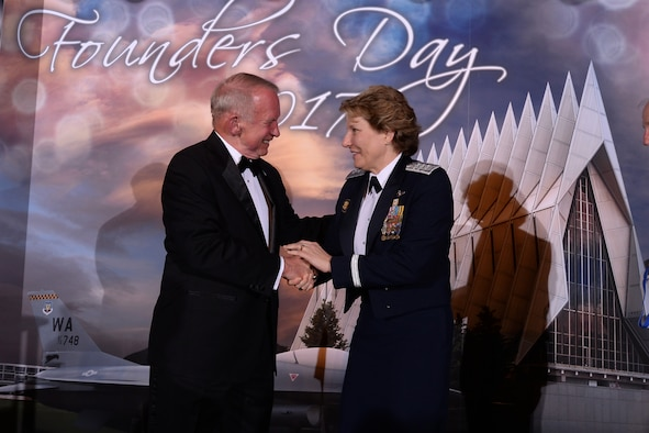 Lt. Gen. Michelle Johnson (left), superintendent of the U.S. Air Force Academy, shakes hands with retired Col. Gary Payton at the Founders' Day Dinner, April 7 at the Falcon Club. Payton, along with retired Gen.s' George Butler and Charles Holland; and David Yost, are the recipients of the 2016 Distinguished Graduate Award. Founders' Day is a traditional celebration of the legacy and future of the Academy and its founders. (U.S. Air Force photo/Mike Kaplan)