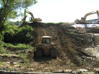 Workers conduct remedial activities on one of the St. Louis Airport Site Vicinity Properties.