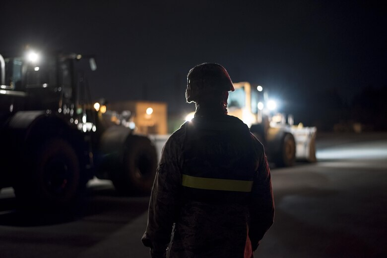 A U.S. Air Force civil engineer Airman from the 18th Civil Engineer Squadron monitors heavy equipment during a no-notice exercise April 12, 2017, at Kadena Air Base, Japan. Airmen from the 18th CES train to ensure they can return Kadena AB's runways to mission-ready as quickly as possible after an attack or natural disaster. (U.S. Air Force photo by Senior Airman Omari Bernard/Released)