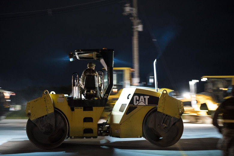 U.S. Air Force civil engineer Airmen mobilize heavy equipment for airfield damage repair during a no-notice exercise April 12, 2017, at Kadena Air Base Japan. Airmen from the 18th Civil Engineer Squadron conduct nighttime runway-repair training to ensure Kadena's mission capabilities aren't hindered from an attack, regardless of the time of day. (U.S. Air Force photo by Senior Airman Omari Bernard/Released)