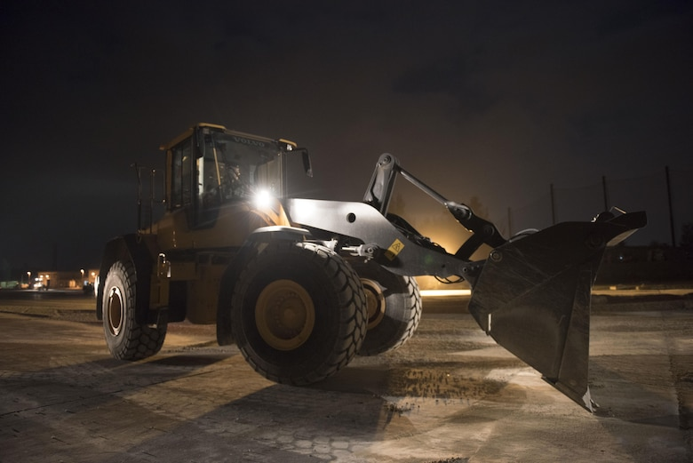 A U.S. Air Force civil engineer Airman operates heavy machinery to perform airfield damage repairs during a no-notice exercise April 12, 2017, at Kadena Air Base, Japan. The 18th Civil Engineer Squadron is capable of quickly repairing a damaged runway to ensure aircraft are able to take off and land safely. (U.S. Air Force photo by Senior Airman Omari Bernard/Released)
