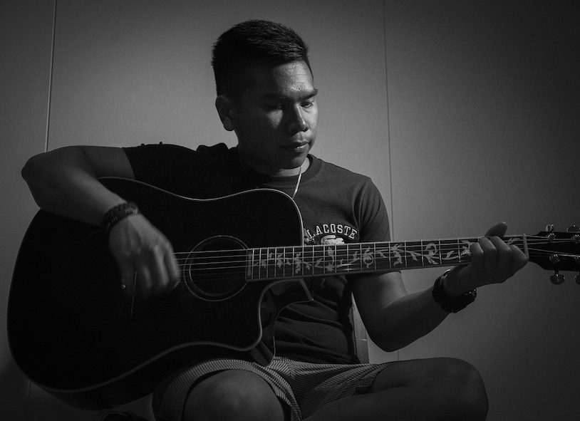 U.S. Air Force Senior Airman Patryk Myko Dela Cruz, a 35th Logistics Readiness Squadron mission generation vehicle equipment maintenance technician, plays a guitar at Misawa City, Japan, April 8, 2017. Dela Cruz played guitar for the base chapel at Minot Air Force Base, North Dakota, which is where he learned of the Leaders Encouraging Airmen Development program. After talking with his leadership, he was able to apply for the program, ultimately getting accepted. (U.S. Air Force photo by Airman 1st Class Sadie Colbert)
