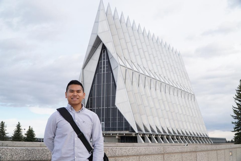 U.S. Air Force Senior Airman Patryk Myko Dela Cruz, a 35th Logistics Readiness Squadron mission generation vehicle equipment maintenance technician, stands in front of the U.S. Air Force Academy at Colorado Springs, Colorado, April, 2016. Dela Cruz did not make it the first time he applied, but with perseverance he did not give up and worked hard toward his goal until it was finally achieved. On March 8, 2017, he received his acceptance letter from his LEAD program counselor. (Courtesy Photo)