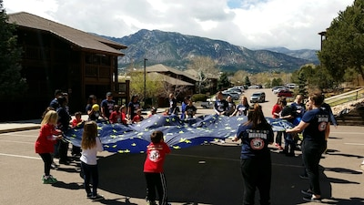 Attendees participate in a parachute activity during the Tragedy Assistance Program for Survivors Good Grief Camp at Cheyenne Mountain Resort, Colorado, Sunday, April 2, 2017. The activity provided play therapy for the 3-to-6 year-olds. (Courtesy photo)