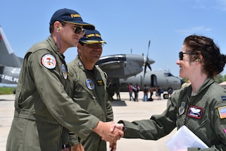 On the very first day of deliveries, U.S. Air Force Capt. Caitlin Miller, 41st Airlift Squadron aircraft commander, meets members from the Callao's Air group No. 8. at the airfield in Piura, Peru on April 6, 2017. The 41st Airlift Squadron delivered 27,900 pounds of disaster relief supplies to Chiclayo, Peru.  (U.S. Air Force photo by Staff Sgt. Jael Laborn)