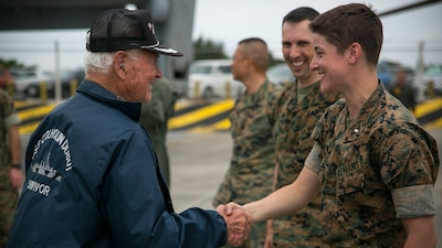 Donald Irwin, a U.S. Navy veteran of World War II, shakes 1st Lt. Lauren Campbell's hand, April 7, 2017, on Marine Corps Air Station Futenma, Okinawa, Japan. Irwin, who served aboard a number of ships during World War II, fought at Midway and Guadalcanal and survived the sinking of the USS Colhoun during the Battle of Okinawa. Irwin returned to Okinawa and exchanged stories with the Marines and Sailors stationed on the island. Irwin is a native of San Jose, California, and Campbell, a native of Redwood City, California, is a material control officer with Marine Medium Tiltrotor Squadron 265, Marine Aircraft Group 36, 1st Marine Aircraft Wing, III Marine Expeditionary Force.
