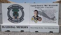 "A memorial wall in honor of Capt. David A. ""Wiz"" Wisniewski is set outside the chapel, March 28, 2017, at Diyarbakir Air Base, Turkey. Wisniewski, an HH-60 Pave Hawk pilot, along with his crew, were killed in action while performing a rescue mission for a wounded British Marine in support of Operation Enduring Freedom. (Courtesy photo)"