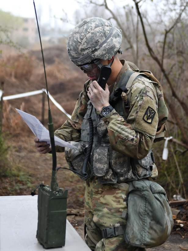 U.S. Army Pfc. Jae Won Choi, 6th Battalion, 52nd Air Defense Artillery medic, sends a simulated medevac request during the 35th Air Defense Artillery Brigade Expert Field Medical Badge preliminary competition at Osan Air Base, Republic of Korea, April 6, 2017. The competition was a first for the 35th ADA, and it gave Soldiers an opportunity to flush out their weaknesses and capitalize on their strengths in the field medic realm. (U.S. Air Force photo by Staff Sgt. Alex Fox Echols III)