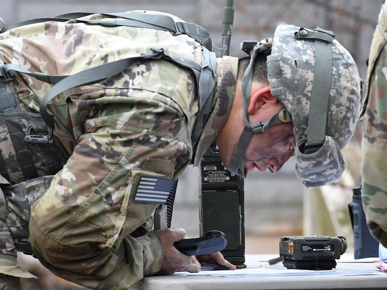 U.S. Army Pfc. Sung Hoon Lee, 2nd Battalion, 1st Air Defense Artillery medic, sends a simulated medevac request during the 35th Air Defense Artillery Brigade Expert Field Medical Badge preliminary competition at Osan Air Base, Republic of Korea, April 6, 2017. The goal of the competition was to bring together medics for training and determine which have the ability and resolve to win at the 8th Army's Expert Field Medical Badge Competition. (U.S. Air Force photo by Staff Sgt. Alex Fox Echols III)