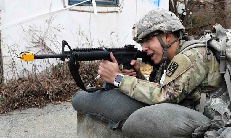 U.S. Army Staff Sgt. Santiago Sendejas, 6th Battalion, 52nd Air Defense Artillery medical NCO in charge, fights off simulated attackers during the 35th Air Defense Artillery Brigade Expert Field Medical Badge preliminary competition at Osan Air Base, Republic of Korea, April 6, 2017. The competition was a first for the 35th ADA, and it gave Soldiers an opportunity to flush out their weaknesses and capitalize on their strengths in the field medic realm. (U.S. Air Force photo by Staff Sgt. Alex Fox Echols III)