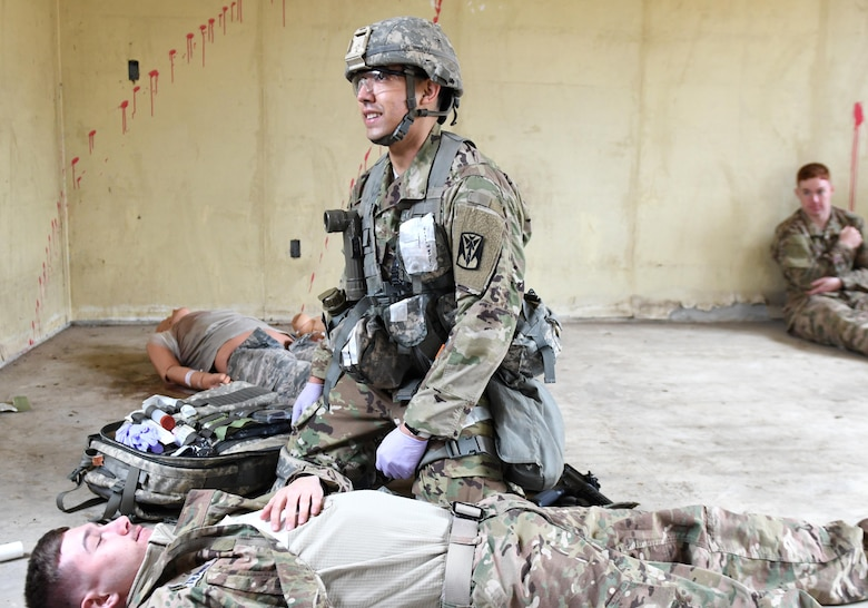 U.S. Army Staff Sgt. Santiago Sendejas, 6th Battalion, 52nd Air Defense Artillery medical NCO in charge, manages a multi-casualty scenario during the 35th Air Defense Artillery Brigade Expert Field Medical Badge preliminary competition at Osan Air Base, Republic of Korea, April 6, 2017. During the competition, participants had to overcome two combat trauma lanes, testing the medic's abilities, determination and strength through scenarios such as medical management, care under fire, tactical movement, decontamination and litter movement. (U.S. Air Force photo by Staff Sgt. Alex Fox Echols III)