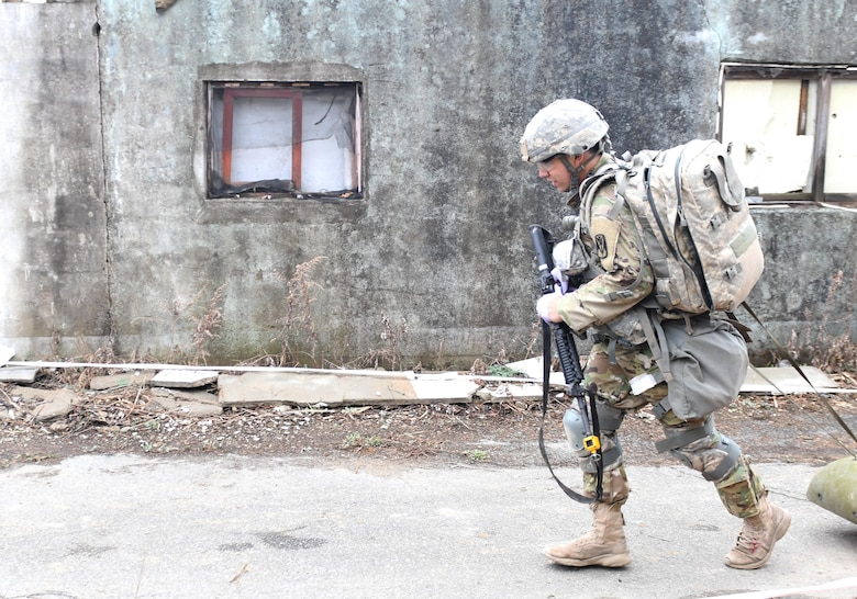 U.S. Army Staff Sgt. Santiago Sendejas, 6th Battalion, 52nd Air Defense Artillery medical NCO in charge, transports a simulated casualty down a combat trauma lane during the 35th Air Defense Artillery Brigade Expert Field Medical Badge preliminary competition at Osan Air Base, Republic of Korea, April 6, 2017. Within the two combat trauma lanes, participant's skills, determination and strength were tested through scenarios such as medical management, care under fire, tactical movement, decontamination and litter movement. (U.S. Air Force photo by Staff Sgt. Alex Fox Echols III)