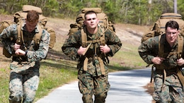 Marines conduct a timed 20 kilometer ruck run during a scout sniper screener at Marine Corps Base Camp Lejeune, N.C., April 3, 2017. The screener tested the Marines physical and mental limits through rigorous training. The Marines are with 2nd Battalion, 8th Marine Regiment, 2nd Marine Division.