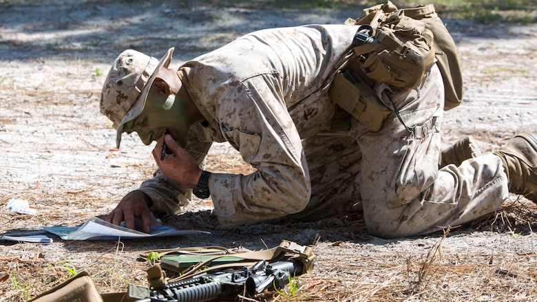 Lance Cpl. Kevin P. Chapman plots points on his map during a scout sniper screener at Marine Corps Base Camp Lejeune, N.C., April 3, 2017. The Marines were evaluated on activities such as foot patrols and land navigation while working on little food and sleep.  Chapman is machine gunner with 2nd Battalion, 8th Marine Regiment, 2nd Marine Division.
