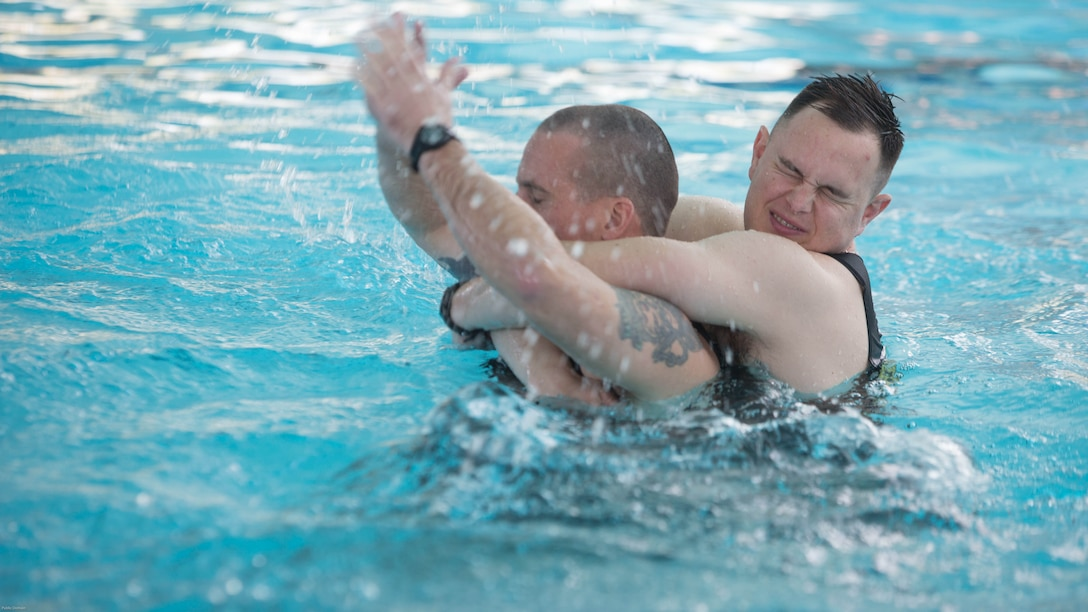Marine Corps Instructors of Water Survival demonstrate rescue scenarios during Water Survival-Advanced training at Marine Corps Base Camp Lejeune, N.C., April 4, 2017. WSA is a week-long course that tests Marines on rescues, strokes and distance swimming. The Marines are WSA instructors from 2nd Law Enforcement Battalion.