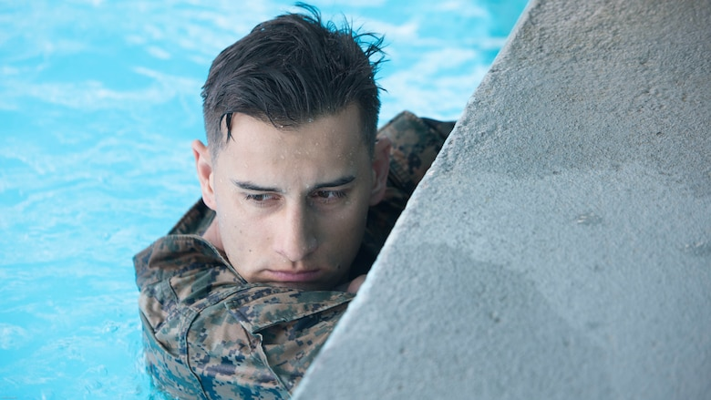 A Marine prepares for a 600 meter conditioning swim during Water Survival-Advanced training at Marine Corps Base Camp Lejeune, N.C., April 4, 2017. WSA is a week-long course that tests Marines on rescues, strokes and distance swimming. The Marine is a student in the course, which is run by 2nd Law Enforcement Battalion.