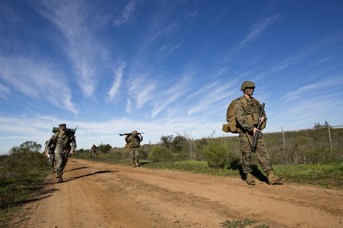 U.S. Marines, with Headquarters and Service Battalion (HQSVCBN), Marine Corps Recruit Depot San Diego, hike to their destination at Marine Corps Air Station Miramar, Calif., Feb. 15, 2017. The Marines hiked through rough terrain to the pistol range during the HQSVCBN Super Squad competition.