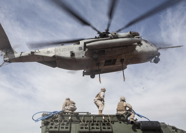 A U.S. Marine Corps CH-53E Super Stallion assigned to Marine Aviation Weapons and Tactics Squadron One lifts a Humvee during a CH-53 tactics exercise at Auxiliary Airfield 2, Yuma, Ariz., April 7, 2017. The CH-53 tactics exercise was part of WTI 2-17, a seven week training event, hosted by MAWTS-1 cadre, which emphasizes operational integration of the six functions of Marine Corps aviation in support of a Marine Air Ground Task Force. MAWTS-1 provides standardized advanced tactical training and certification of unit instructor qualifications to support Marine Aviation Training and Readiness and assists in developing and employing aviation weapons and tactics.