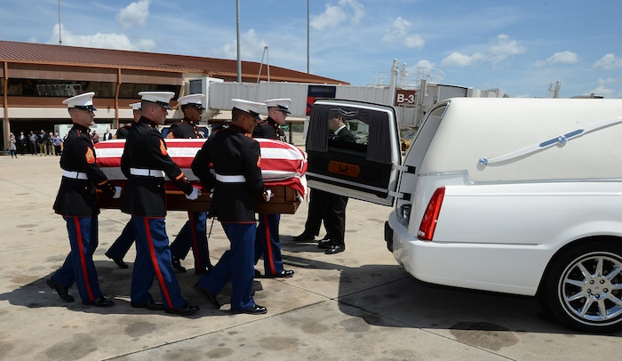 Marines attached to Marine Corps Logistics Base Albany funeral detail transport a casket with the remains of Marine Pfc. James O. Whitehurst from an aircraft to a hearse at the Tallahassee International Airport in Tallahassee, Fla., April 11. Whitehurst was killed in action at the battle of Tarawa during World War II, Nov. 20, 1943.