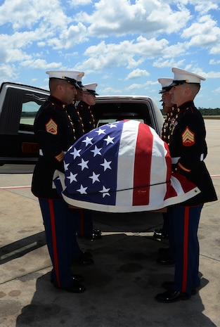 Marines attached to Marine Corps Logistics Base Albany funeral detail carry a casket with the remains of Marine Pfc. James O. Whitehurst to a hearse at the Tallahassee International Airport in Tallahassee, Fla., April 11. Whitehurst was killed in action at the battle of Tarawa during World War II, Nov. 20, 1943.