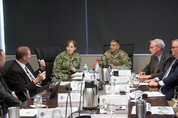 Scott Rosbaugh, DLA Distribution Future Plans director, left, outlines DLA Distribution's Campaign Plan to DLA Land and Maritime commander Navy Rear Adm. Michelle Skubic, second from left, during a roundtable discussion with DLA Distribution commander Army Brig. Gen. John Laskodi.