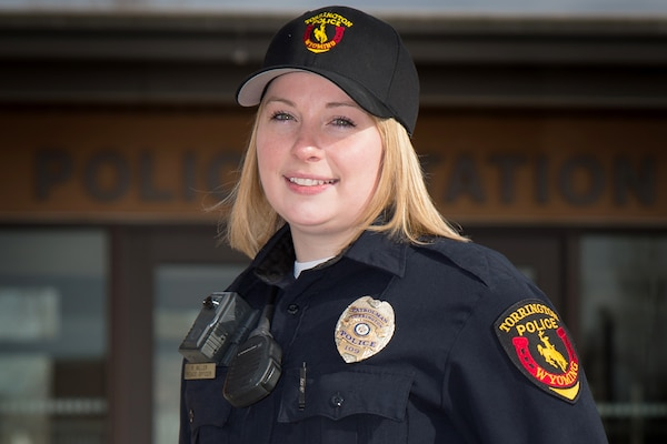 Air Force Staff Sgt. Rebekah Miller stands in front of the Torrington police department in her police uniform, in Torrington, Wyo., March 10, 2017. Miller has been with the Wyoming Air National Guard for six years and is serving as a command post specialist. She has also been an officer with the Torrington police department for two years. Wyoming Air National Guard photo by Air Force Senior Master Sgt. Charles Delano