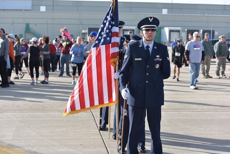 The 180th Fighter Wing Honor Guard prepares to post the colors before the start of the I Believe I Can Fly 5k race at the Toledo Express Airport in Swanton, Ohio on April 9, 2017. The wing's Company Grade Officer Council partnered with the non-profit organization, The Arms Forces, as well as local law enforcement, fire departments and civilian volunteers to host the third annual race which had approximately 270 participants, to raise awareness for military members with post-traumatic stress disorder and traumatic brain injury. The race, now in its third year, provides runners of all ages, the rare opportunity to run a unique course, down the taxiways used by Northwest Ohio's very own 180FW, while also promoting awareness and raising funds to benefit our veterans who have given so much to our great nation. (U.S. Air National Guard photo by Tech. Sgt. Nic Kuetemeyer)