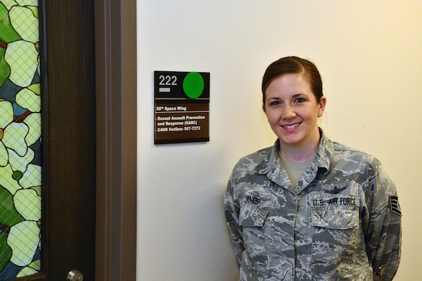 SCHRIEVER AIR FORCE BASE, Colo.-- Staff Sgt. Velnette Janes, Schriever volunteer victim advocate, stands outside the Sexual Assault Response and Prevention Office at Schriever Air Force Base, Colorado, Tuesday, April 11, 2017. Volunteer victim advocates provide a range of support services for sexual assault survivors, and help victims try to regain a sense of normalcy following an assault. (U.S. Air Force photo/Brian Hagberg)