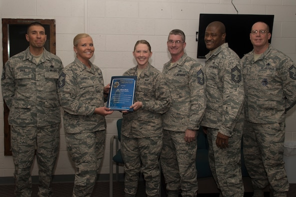 Airmen 1st Class Allison S. Block, a 49th Force Support Squadron career development apprentice, receives the March Chief's Choice Award, from Chief Master Sergeant Sarah Esparza, the 49th FSS superintendent, April 10, 2017, at Holloman Air Force Base, N.M. (U.S. Air Force photo by Tech. Sgt. Amanda Junk)