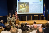 Col. David Enfield, 433rd Mission Support Group commander, gives a 433rd Airlift Wing mission brief to members of the Air Force Scientific Advisory Board April 11, 2017 at Joint Base San Antonio-Lackland, Texas. The SAB is a Federal Advisory Committee that provides independent advice on matters of science and technology relating to the Air Force mission, reporting directly to the Secretary of the Air Force and the Chief of Staff of the Air Force.  (U.S.  Air Force photo by Benjamin Faske)