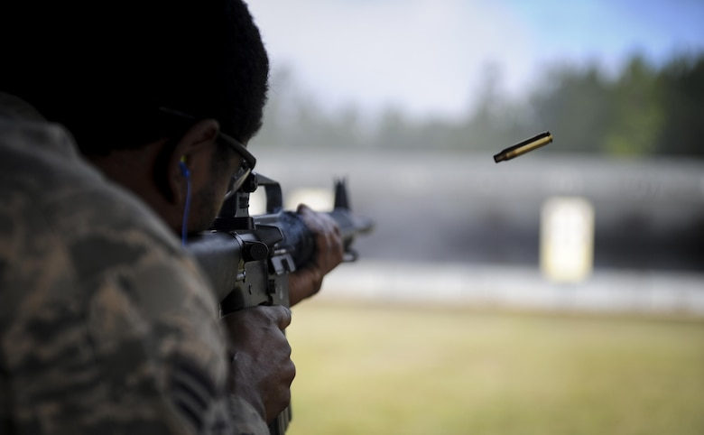 Senior Airman Arry Milcette, a crew chief with the 1st Special Operations Aircraft Maintenance Squadron, fires an M-16 rifle during a competition at Hurlburt Field, Fla., April 4, 2017. Milcette participated in the Excellence in Competition event, a rifle competition held by the 1st Special Operations Security Forces Squadron. (U.S. Air Force photo by Airman 1st Class Dennis Spain)